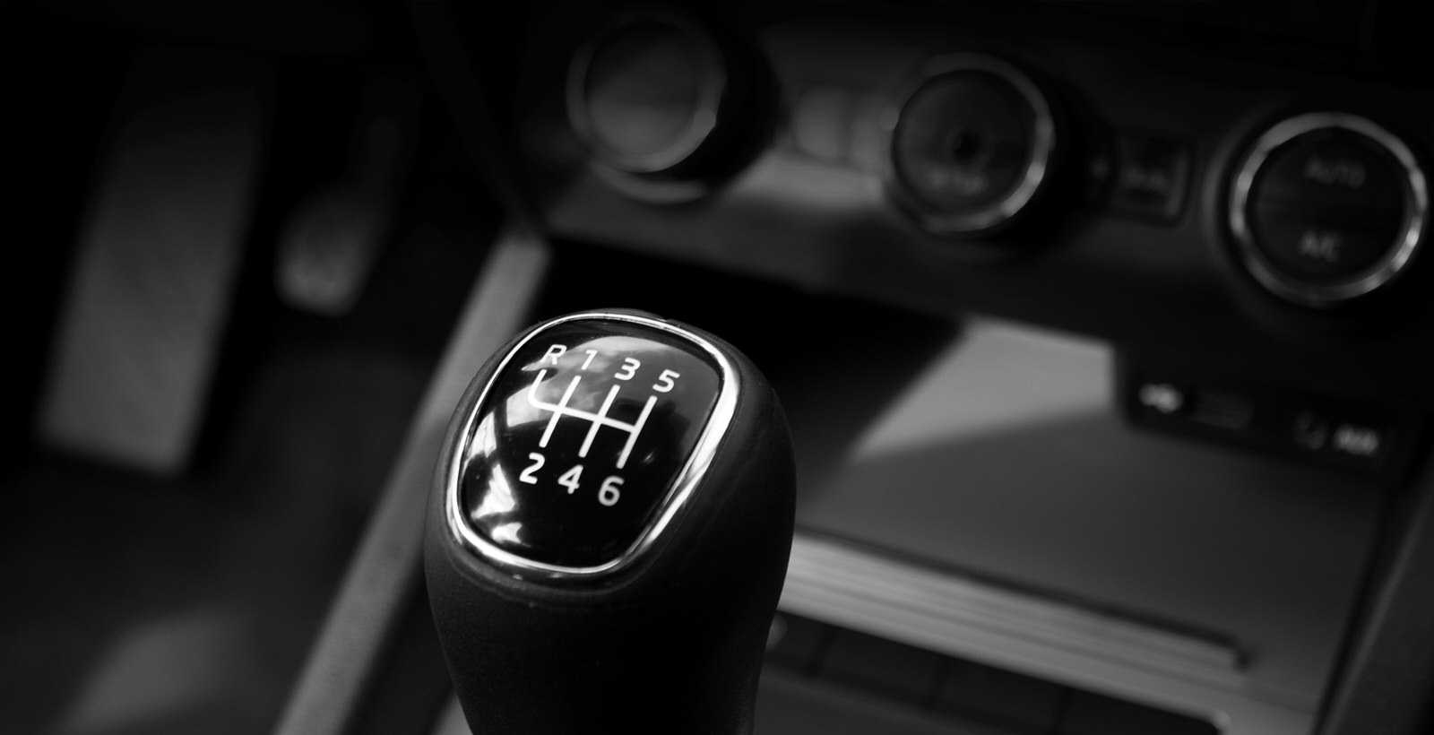 black gearshift inspected by Q2 Management Inc.