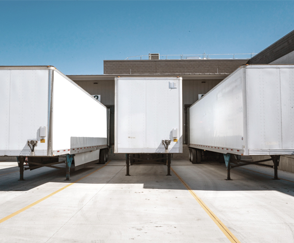 three trailers at warehouse dock